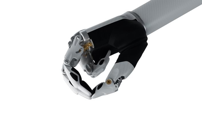 Image of the bebionic hand small in white in the tripod grip.