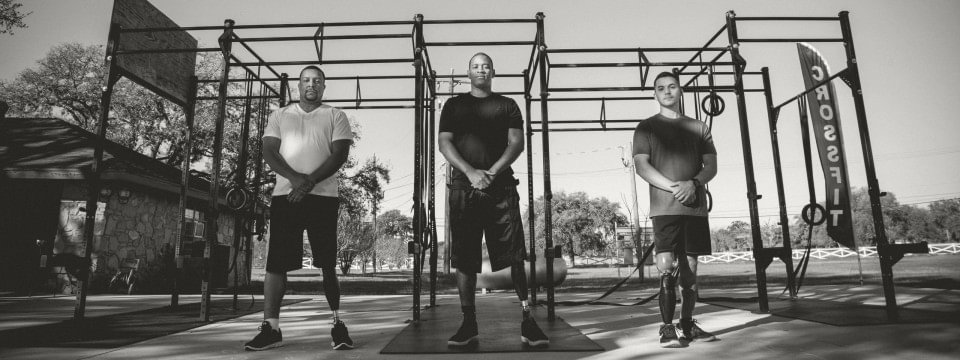 three veterans at an outdoor gym, all wearing x3 microprocessor knees