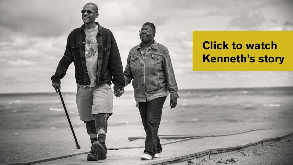 Kenneth walking with wife using C-Braces.