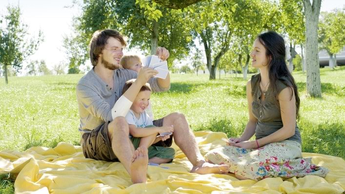 Michelangelo prosthetic hand user with family picnic