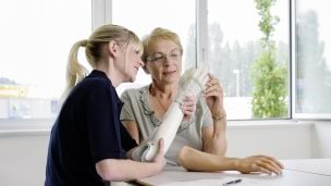 Prosthetist consulting with hand amputee